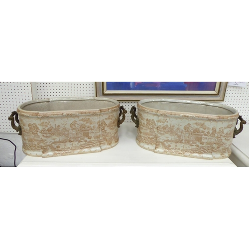 51 - CHINESE STYLE JARDINIERES, a pair, twin handled ceramic decorated, 55cm W x 21cm H. (2)
