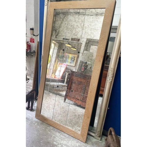 52 - WALL MIRROR, antiqued segmented plate in a light oak frame, 200cm H x 100cm.