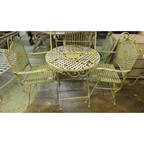 19 - GARDEN SET, including table, 74cm x 69cm diam, and four chairs, 97.5cm H, 1950's French style painte...