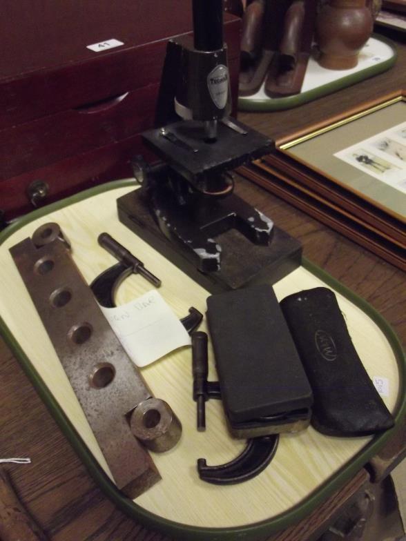 Tecnar Swift microscope, steel sign bar, and five micrometers