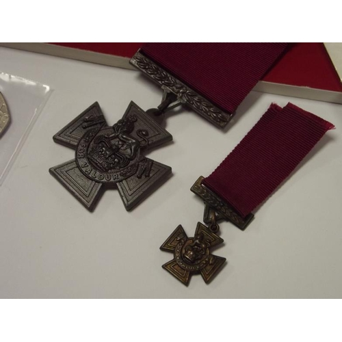17 - Victoria Cross and miniature copies, with VC First Day Cover, and VC 50 pence 2006, together with Sp...