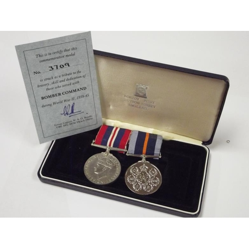 18 - Two WWII British medals on bar, being British War Medal and Unofficial Bomber Command Medal, with la...