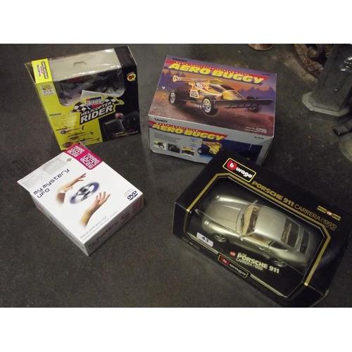 43 - Burago boxed scale model Porsche 911 Carrera, remote control helicopter, etc....