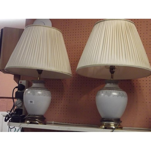 59 - Pair of contemporary table lamps with pleated fabric shades....