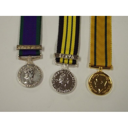 18 - Three miniature medals - WWI Territorial Force Medal; Africa General Service Medal, Kenya Bar; and G...