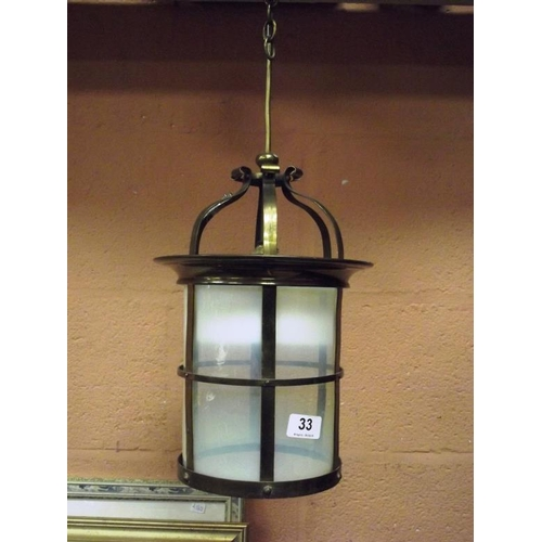 33 - Gilded brass lantern light with vaseline glass shade....
