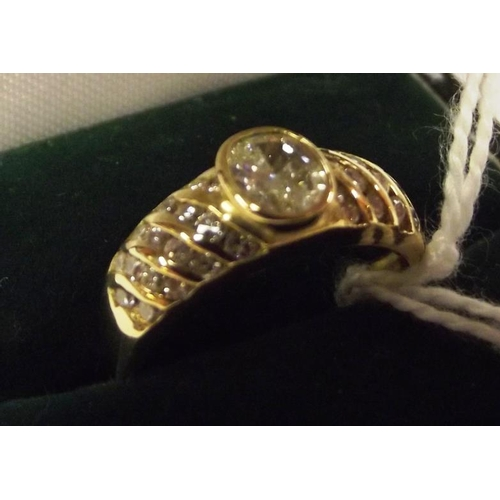 16 - 18 ct. yellow gold ring set with centre diamond, over 0.5 ct., with 32 small diamonds to shoulders, ...