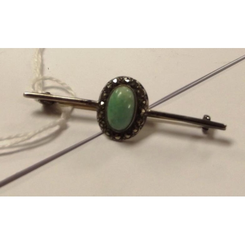 21 - Silver bar brooch set with jade and marcasite....