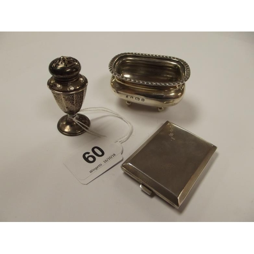 60 - Silver matchbook holder with engine turned decoration, open silver salt, and a silver pepper pot....
