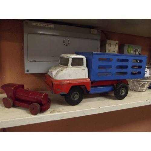 25 - Vintage tin plate truck, and a wooden train....