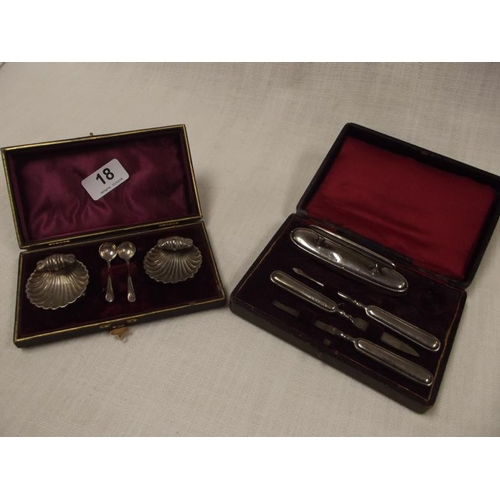 18 - Pair of silver shell form open salts, in case with spoons, and a silver mounted manicure set in case...