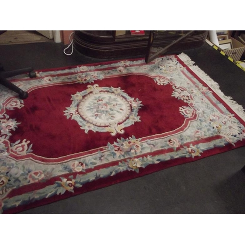 30 - Chinese red ground floral rug....