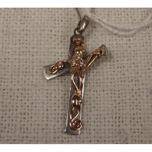 43 - Clogau gold crucifix pendant set with three small diamonds, no. 279/200, on a fine link white gold c...