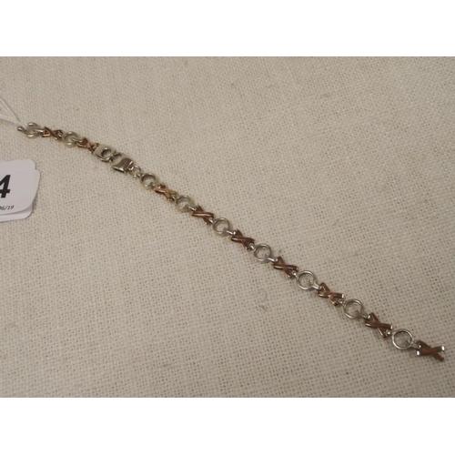44 - Yellow/white metal 'oxo' link bracelet, marked 375, 10.8 g....