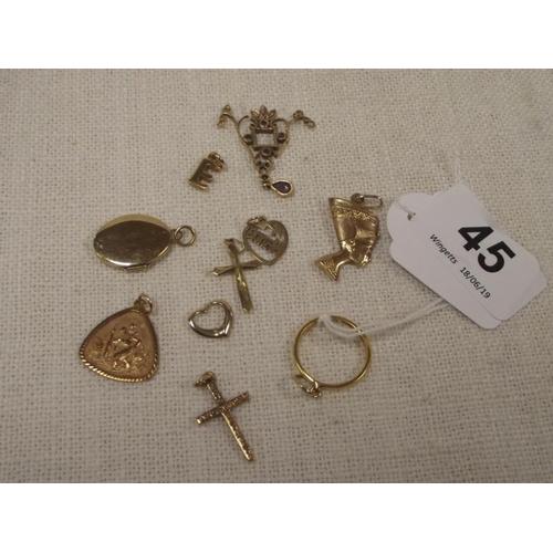 45 - Ten various yellow gold/metal pendants....