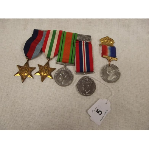 5 - Set of four World War Two medals, and a Victorian commemorative medal....