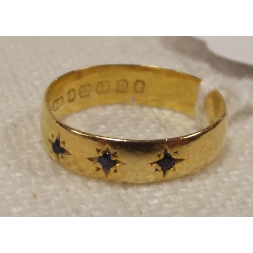 55 - 22 ct. yellow gold ring set with three small sapphires, size T, 3.8 g....