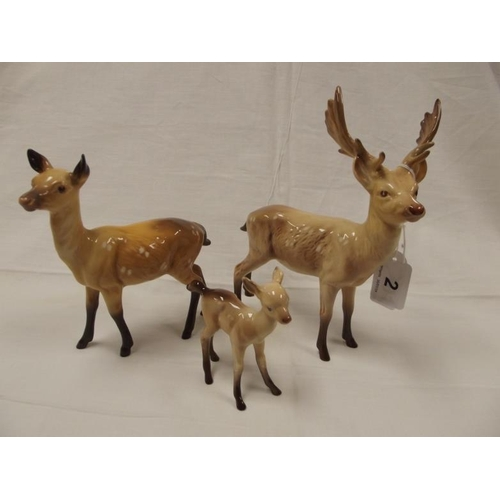 2 - Beswick Deer - Stag, Doe and Fawn, model nos. 981, 999A and 1000B....