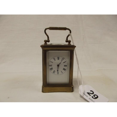 29 - Small gilded brass cased carriage clock, 3.25 in. high....