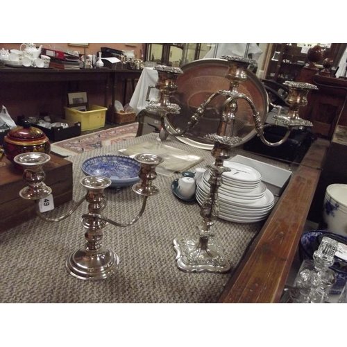 49 - Ornate plated two-branch candelabra with centre sconce, and one other smaller....