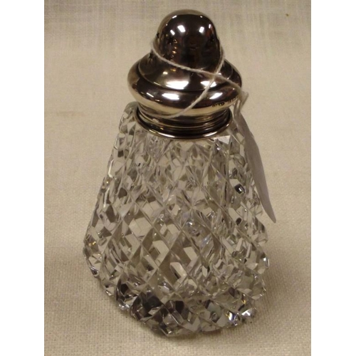 37 - Silver mounted sifter having cut glass body, 5 in. high....