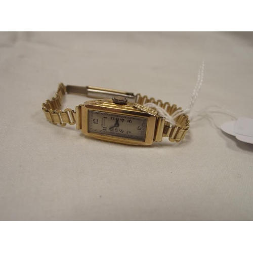 13 - Benson London 9 ct. gold cased ladies wristwatch on rolled gold bracelet....