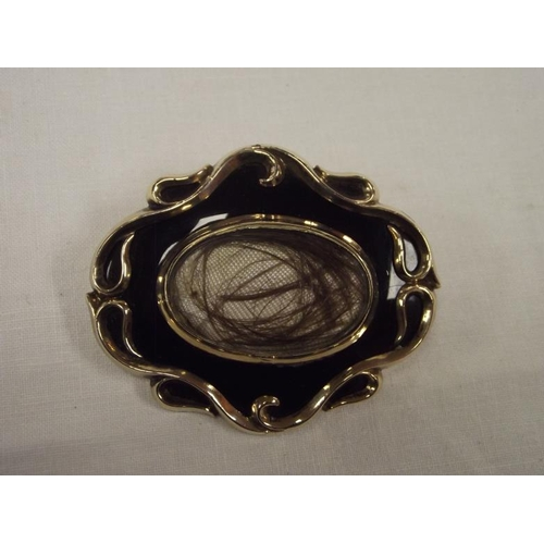 35 - Victorian 9 ct. gold mourning brooch....