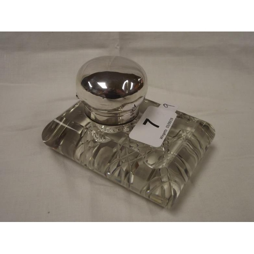 7 - Cut glass inkwell with hinged domed silver cover....