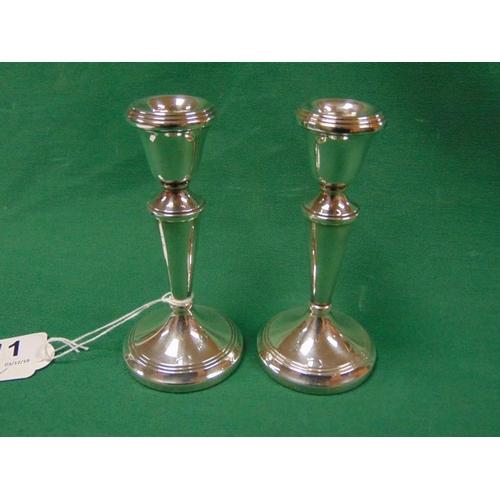 11 - Pair of silver candle sticks, Birmingham 1976....