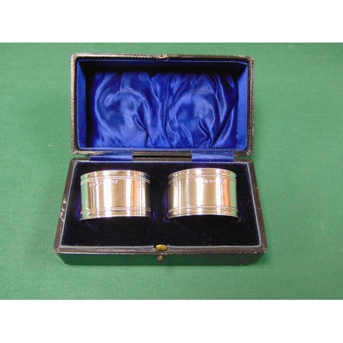 12 - Boxed pair of silver napkin rings, Birmingham 1898....