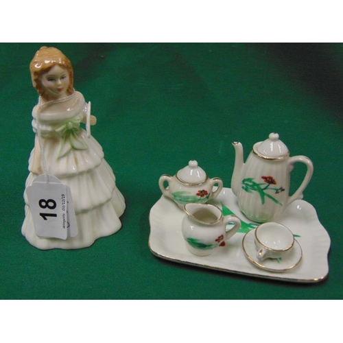 18 - Royal Doulton figure 'Julie' HN2795 and a Victorian doll's tea set....