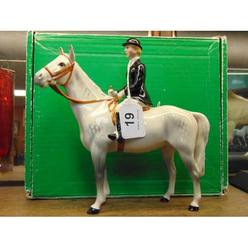 19 - Beswick Huntswoman with black jacket, on grey horse, with box....