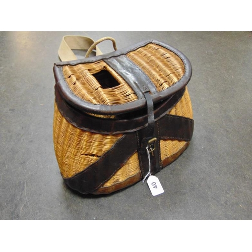40 - Vintage wicker and leather creel with canvas strap....