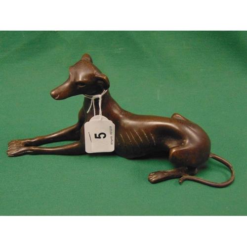 5 - Bronze figure of a recumbent greyhound, 8.75