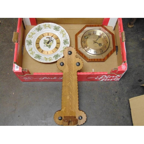 58 - Two wall clocks and a rack....
