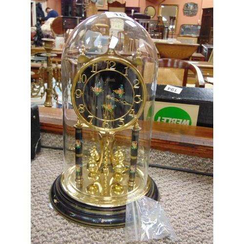 16 - Kundo anniversary clock under glass dome.