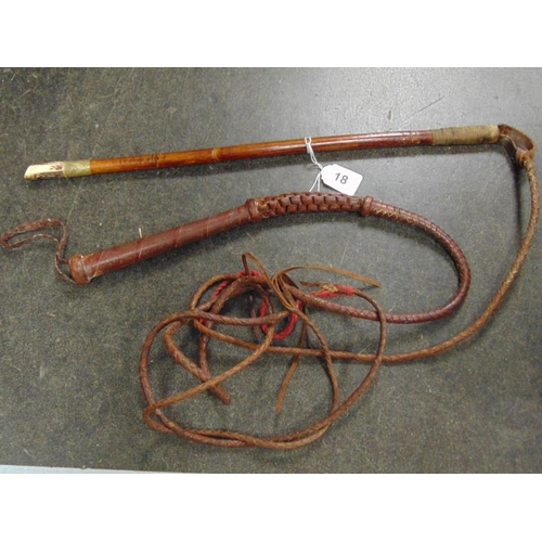 18 - Hunting whip, wooden handle incorporating a carved stag horn whistle, and another plaited leather hu...