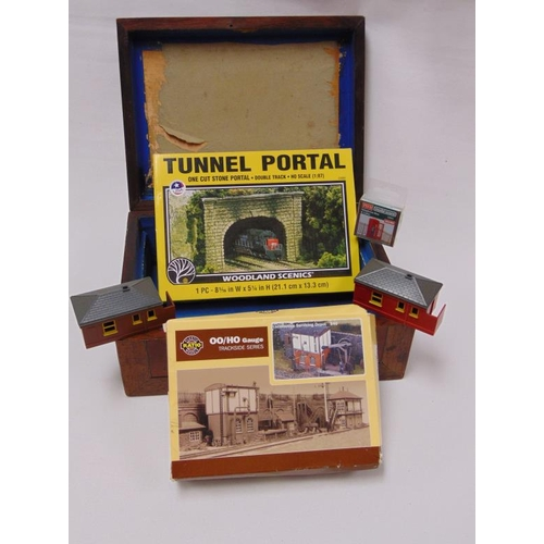27 - Inlaid box containing model railway accessories.