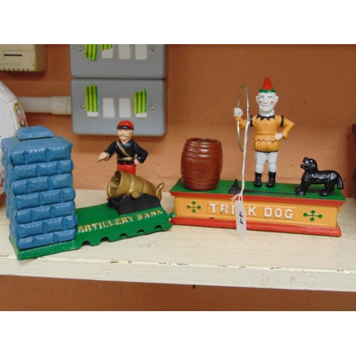 44 - Two painted reproduction novelty money boxes, Trick Dog and Artillery Bank,