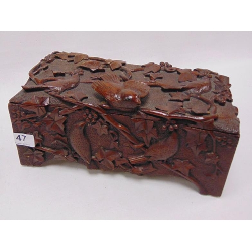 47 - Black Forest type carved wooden box containing a chess set etc.