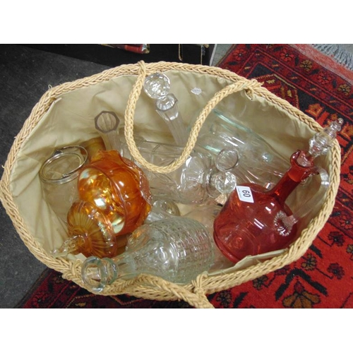 60 - Basket of glassware, to include a Cranberry glass decanter , carnival glass bowl etc.