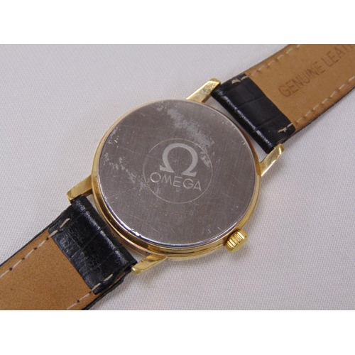 9 - Omega Seamaster gents wristwatch, gold plated case, black dial with hour batons and date aperture, m...