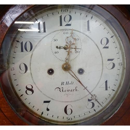 20 - An early 19thC mahogany and oak longcase wall clock, the circular dial signed R. Holt Newark, with e...