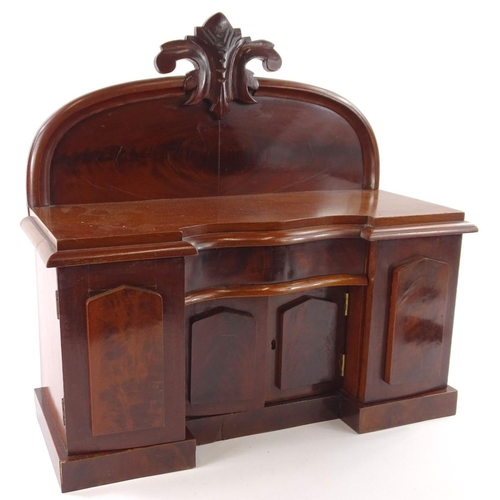 24 - An apprentice made Victorian style sideboard, the raised back carved with scrolls and leaves, the in...