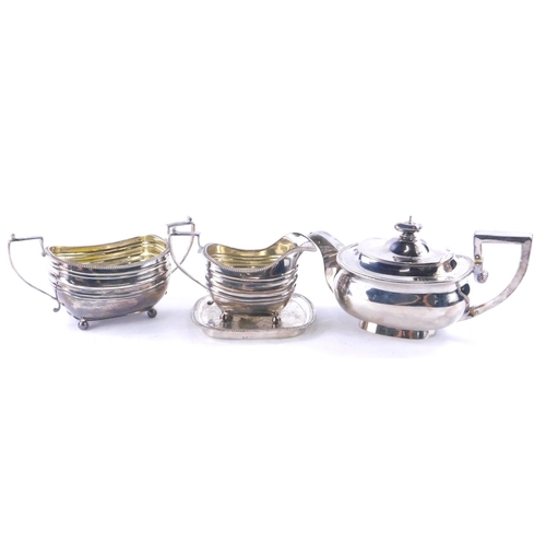 3 - An associated George III silver tea service, each piece of rectangular form with a gadrooned edge, c...