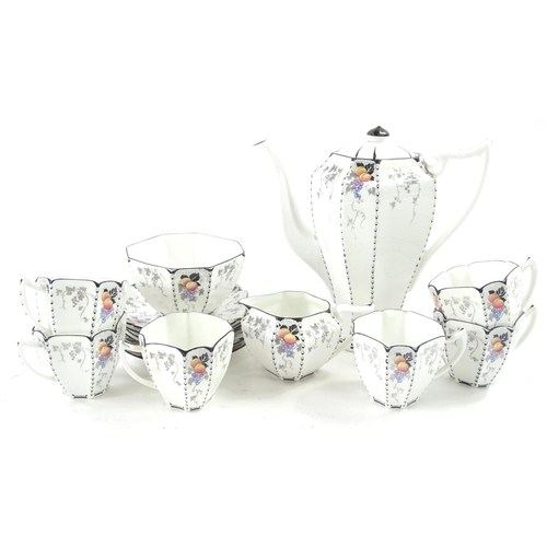 36 - A Shelley porcelain Art Deco style part coffee service, decorated with fruit, with faceted cups, cof...