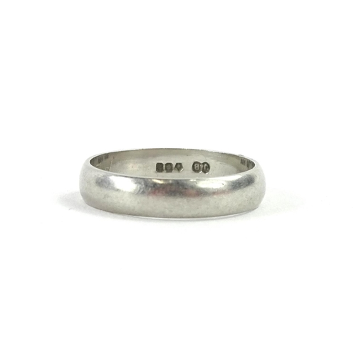 56 - A platinum wedding band, with marks to inside P2-4M, 4g all in....