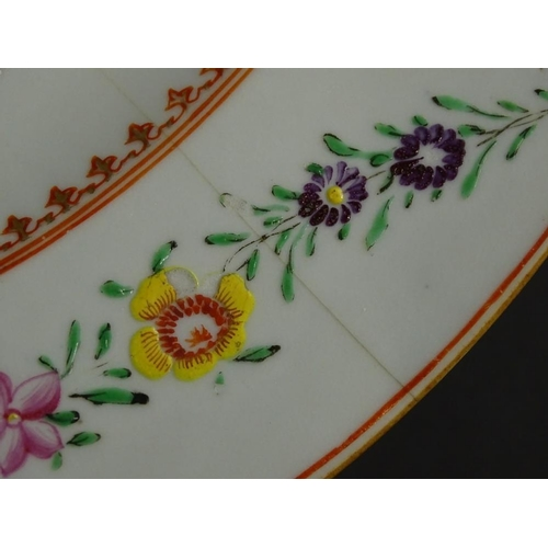 11 - A late 18th/early 19thC Chinese famille rose large plate or charger, decorated with flower swags etc...