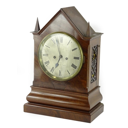 19 - A Victorian figured mahogany mantel clock, the silver dial stamped Wakefield, South Street, Grosveno...