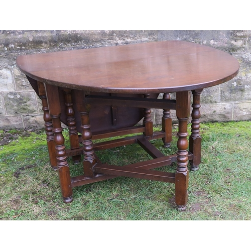 1 - A Georgian style gate leg dining table, 66ins x 42ins